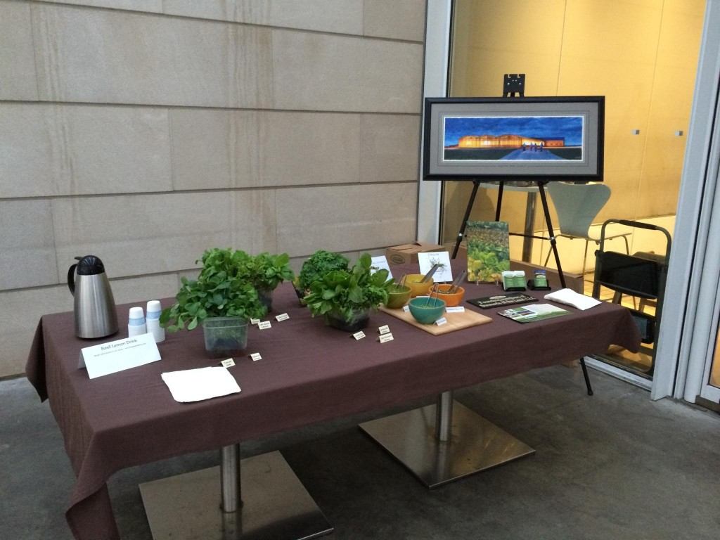 Living Water Farm demo table of sample greens, micros & literature.